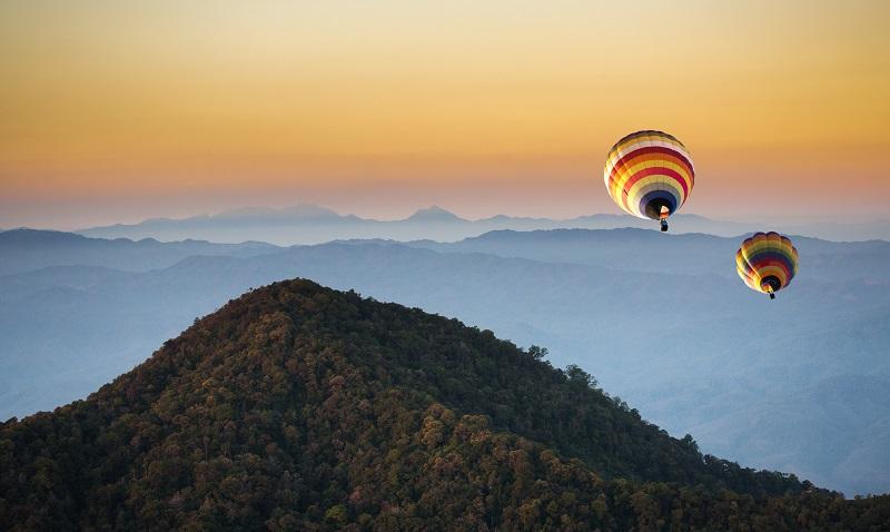 hot air balloon on the mountain north of thailand winter season_rw4MRSkOnfg