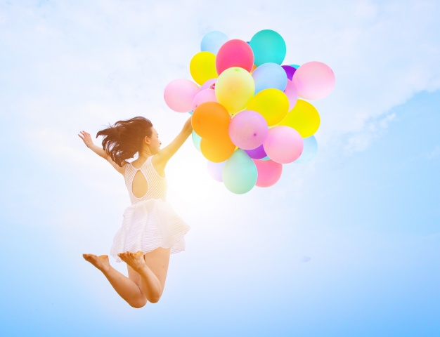 girl-jumping-with-balloons_1112-545