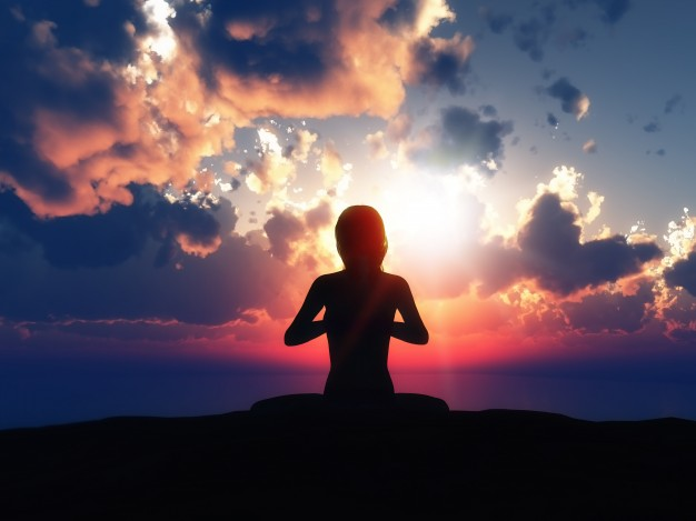 yoga-silhouette-with-a-sunset-background_1048-1482