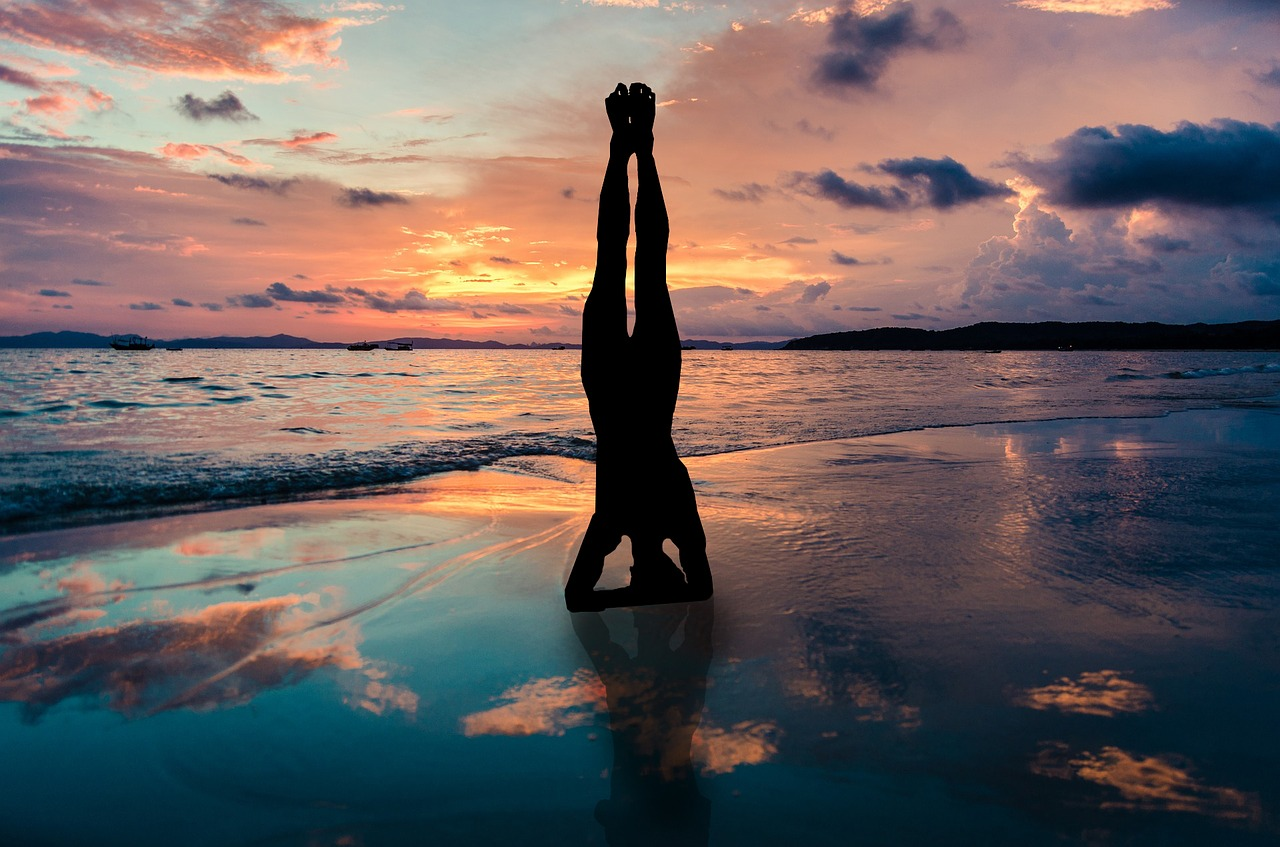 yoga-stand-in-hands-silhouette-2149407_1280