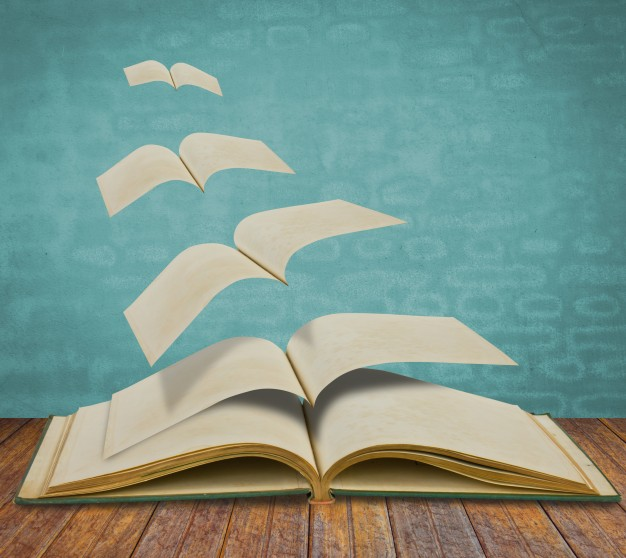 open-flying-old-books_1232-2096